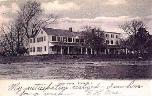 "(Circa 1900) Located on the Manasquan River, foot of Union Lane, burned down February 1914. Second floor room, near corner, occupied by Robert Louis Stevenson, May 1888. Wrote portion of ""Master of Ballen Tree"" here."